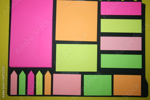 set of colorful stickers for notes on a yellow background