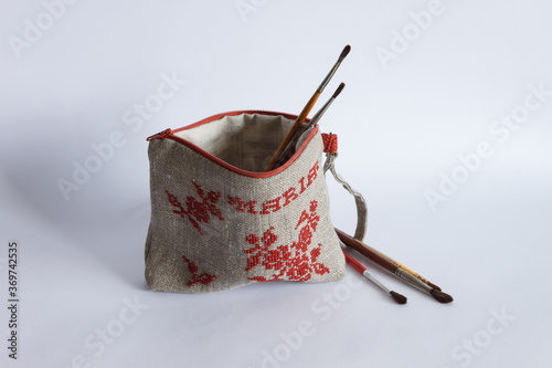 Fotografija Makeup bag made from linen cloth and embroidered with red threads
