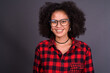 Happy young beautiful African hipster woman with eyeglasses