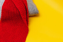 Part Of A Grey Sweater And Red...