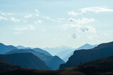Fototapeta Do pokoju - Awesome aerial view to great mountains in distance behind deep gorge. Scenic mountain landscape with giant rockies and deep abyss. Wonderful highland scenery with huge cliff. Big rocks and precipice.