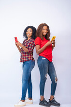 Young African Women Using Thei...