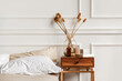 Leinwandbild Motiv Cozy details in white contemporary bedroom interior with gypsum stucco on white walls