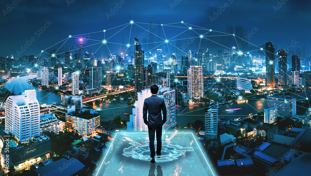 Fototapeta Business man on futuristic network city technology background