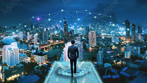 Obraz Business man on futuristic network city technology background - fototapety do salonu