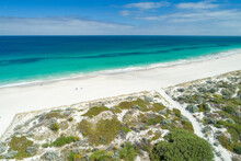 Aerial Views Over Sandy White Beaches With Blue Skies In Summer