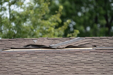 Roof Shingles Have Been Damaged By High Winds And Strong Storms