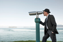 Businessman Looking Through Spyglass