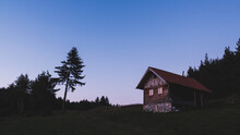 Mountain Log Cabin In The Evening