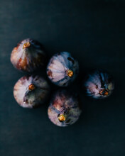 Figs On A Dark Wooden Table Background.