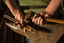 A Farrier's Hands Clasped Abov...