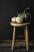 White Gourds And Pumpkin On Ol...
