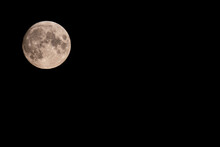 Beautiful Full Moon Of August, August's Sturgeon Supermoon In A Summer Night. Moon Above, On The Left Side And Empty Space On The Right Side For Writing
