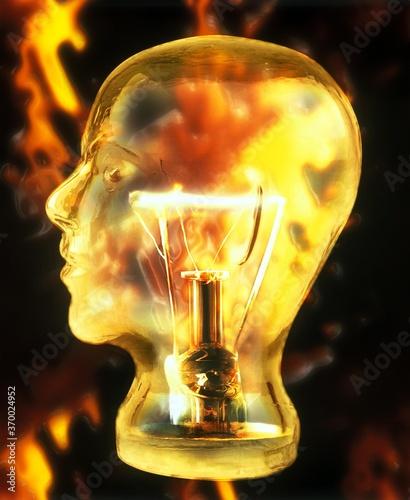 фотография Glass Head inlaid with Light Bulb, Symbolic Image