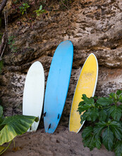 Surf Boards Leaning Against A Rock.