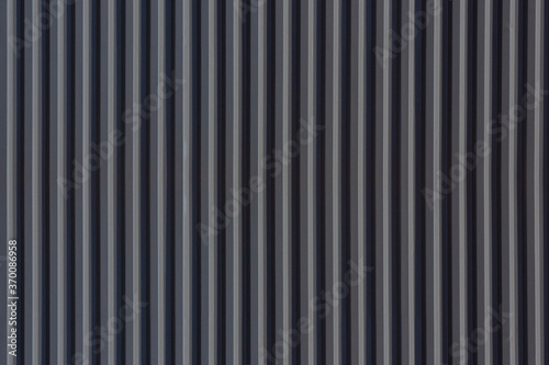 Cuadros en Lienzo A corrugated fence of  grey metal sheets