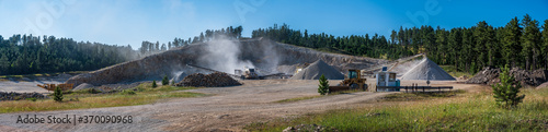 Open pit sand and gravel quarry with heavy equipment Wallpaper Mural