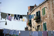 house drying clothes in the street
