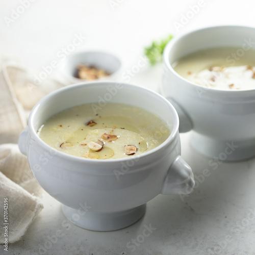 Fotografija Homemade white asparagus soup with hazelnut