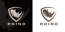 Concept Rhino Head And Shield Company Logo Icon. Premium Rhinoceros Brand Identity Emblem. African Animal Business Sign. Vector Illustration.