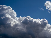 White Cumulus Clouds On A Blue...
