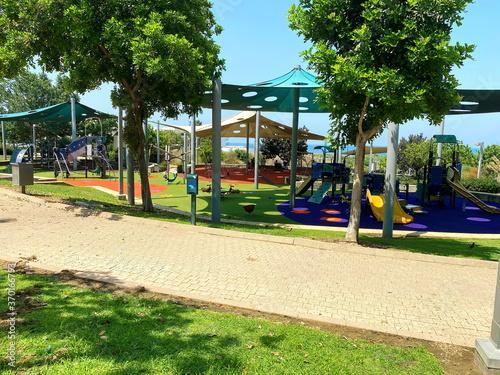 Fototapeta Children playground and sport complex in small park obraz na płótnie