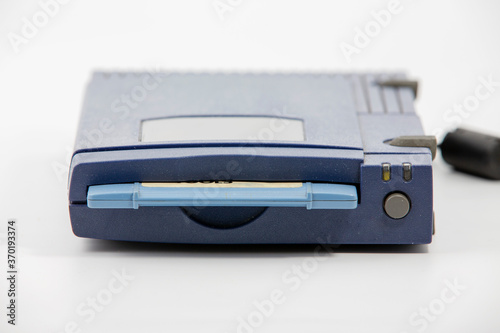 Fényképezés zip drive with blue disk inserted over white background