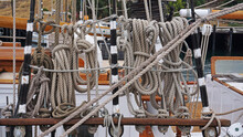 Lines, Ropes, Halyards, Knots In The Rigging Of A Two Masted Brigantine Sailing Boat Replica