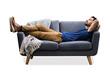 Leinwandbild Motiv Man Relaxing On Sofa