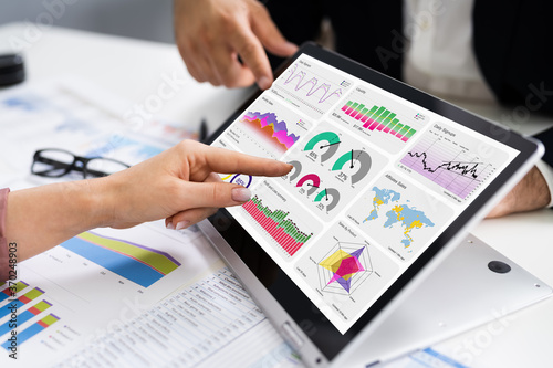 Obraz Financial Analyst Using Convertible Laptop Screen - fototapety do salonu