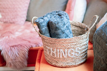 Wicker Storage Basket With Woolen Blanket Inside And Cushions