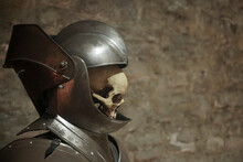 Human Skull In A Knight Helmet On A Gray Background