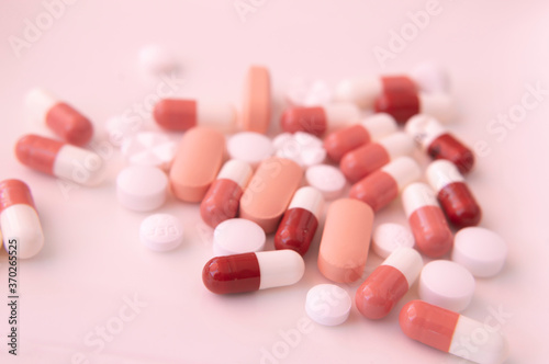 Obraz na płótnie Macro of Different kind of pills and capsules against a white background