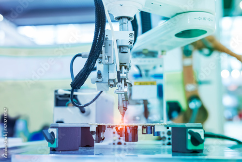Obraz soldering iron tips of automated manufacturing soldering and assembly pcb board - fototapety do salonu