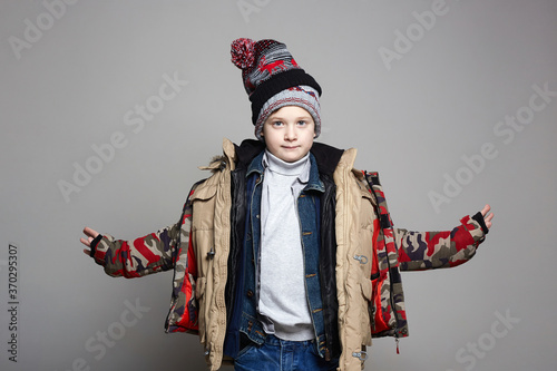 Fototapeta Kid wore all his clothes. Funny Boy in winter outerwear obraz