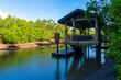 Incredibly beautiful natural landscape, a pier for boats to the river, in a green forest overlooking the mountains.