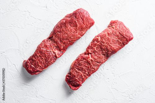 Raw set of denver steak on a white stone background top view Fototapete
