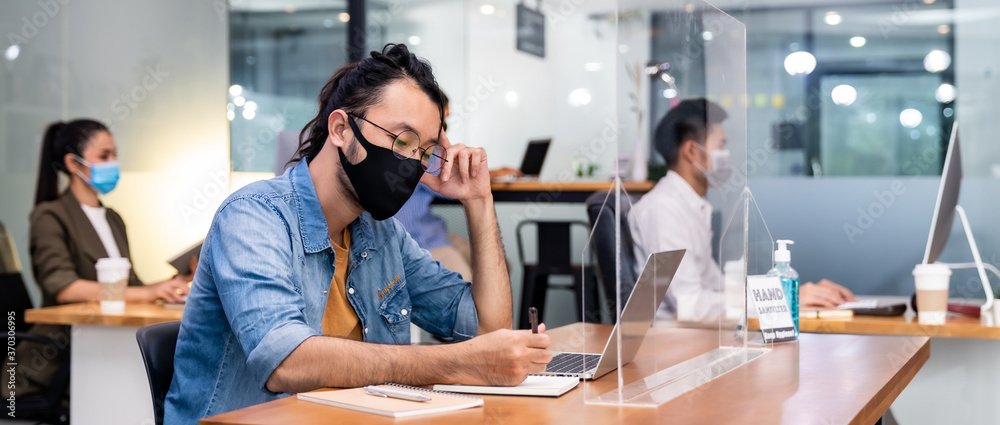 Fototapeta Social distance office with business team wear face mask as new normal life