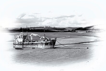 Old Dredger Boat On The Coastline Beach At Ferryside Carmarthenshire Wales Which Is A Popular Travel Destination Tourist Attraction Landmark Of The Town Black And White Monochrome Image Stock Photo