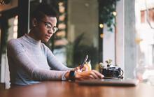 Pensive Afro American Photogra...