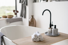 Towels On Tub With Modern Blac...