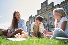 Cheerful Kids Spending Time With Mom Outdoors