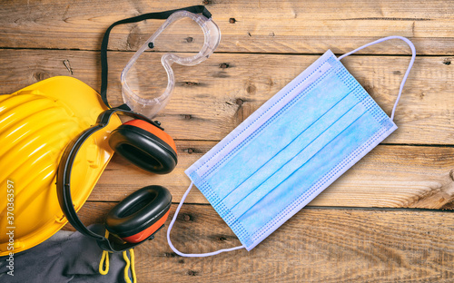 Obraz Work safety accessories and protective mask on wooden background - fototapety do salonu