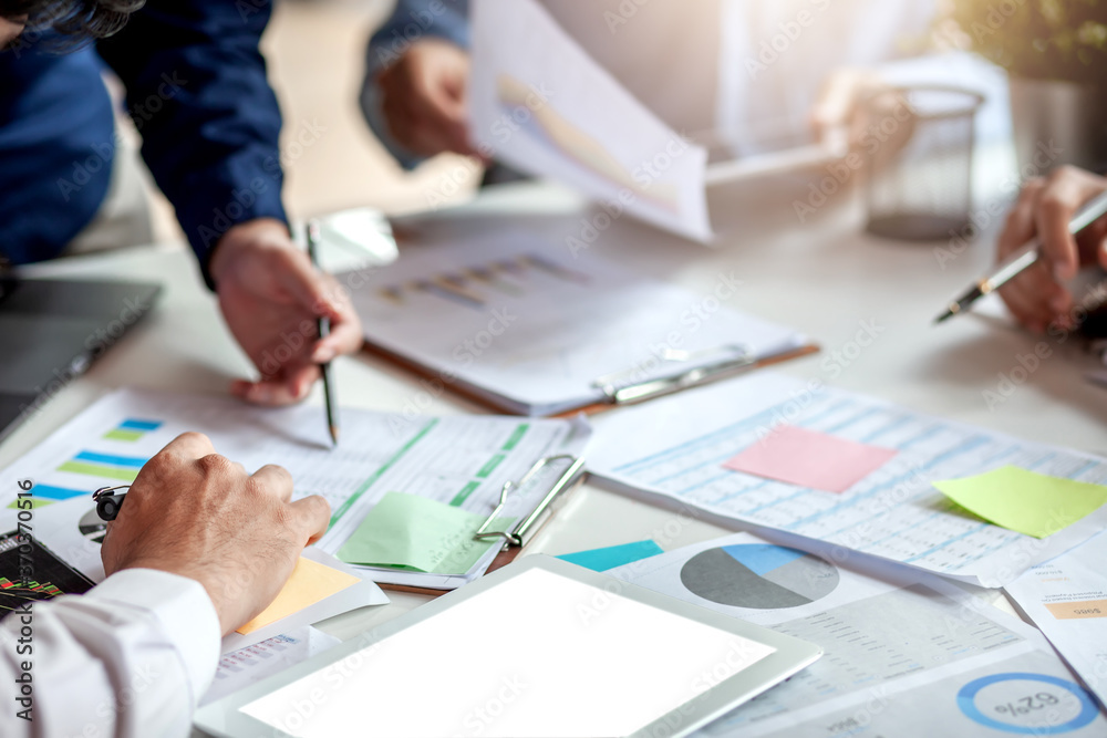 Fototapeta Investor group, business meeting and financial graph data analysis during the meeting.