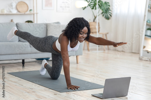 Fotografie, Tablou Attractive black woman making morning exercise at home