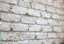 Selective Focus Of Perspective View Of Old Brick Wall, Pattern Background Of  White Brick Wall