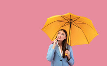 Portrait Of Angry Young Girl Holding Yellow Umbrella