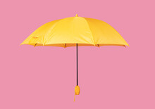 Opened Yellow Umbrella Isolated On Pink Background
