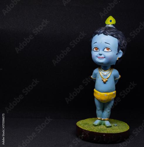 Платно Cute and innocent idol of Hindu God Lord Krishna; right orientation