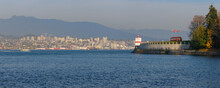 Panoramic View Of Brockton Point In Stanley Park With Trolley Car And Lighthouse And North Vancouver